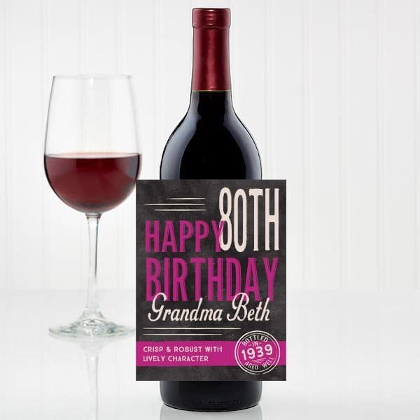 Inexpensive 80th Birthday Gift Ideas - Impress the wine-lover on her big day with a personalized bottle of wine!  Add this cute label to her favorite bottle of wine to create an inexpensive gift that's sure to be a hit!  #80thBirthdayIdeas #wine